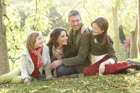 Family Group Relaxing Outdoors In Autumn Landscape Stock Photo - 7185106