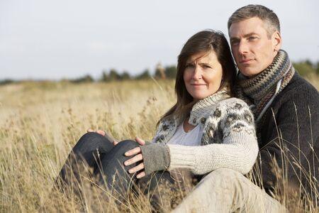Romantic Young Couple In Autumn Landscape photo