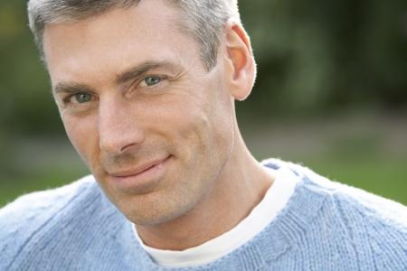 man close up: Chiudere su ritratto di uomo permanente Outside In Autumn Landscape  Archivio Fotografico