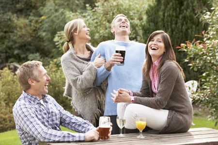 Group Of Friends Outdoors Enjoying Drink In Pub Garden photo