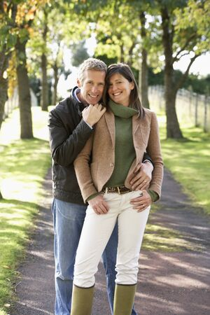 Portrait Of Romantic Couple Enjoying Outdoor Walk Through Autumn Park Stock Photo - 7184656