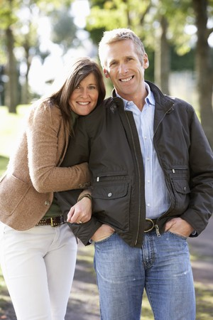 couples hug: Portrait Of Romantic Couple Enjoying Outdoor Walk Through Autumn Park