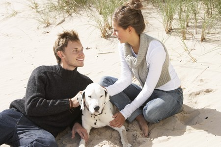 Portrait Of Romantic Teenage Couple On Beach With Dog Stock Photo - 7184790