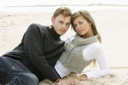 Portrait Of Young Couple On Beach photo