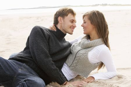 Young Romantic Couple Relaxing On Beach Together Stock Photo - 7182302