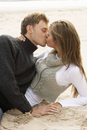 Portrait Of Romantic Young Couple Kissing On Beach Stock Photo - 7184747