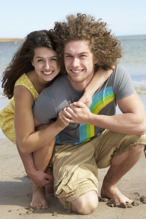 Affectionate Young Couple Having Fun On Beach photo