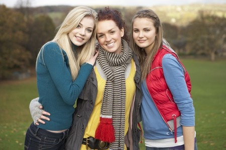 Group Of Three Teenage Female Friends In Autumn Landscape photo