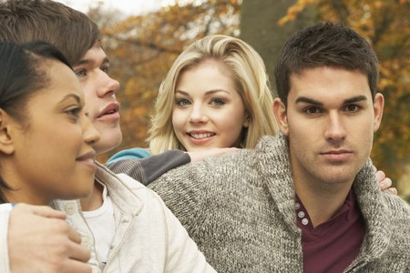 Close Up Of Group Of Four Teenage Friends In Autumn Woodland Stock Photo - 7175799