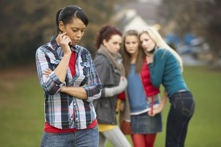 Upset Teenage Girl With Friends Gossiping In Background Stock Photo - 7178584