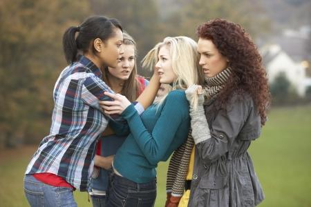 Group Of Female Teenagers Bullying Girl