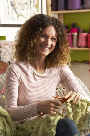 jumpers: Woman Sitting In Chair Knitting