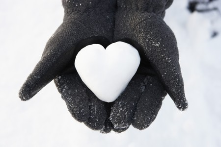 heart shape with hands: Close Up Of Hands Holding Heart Made Out Of Snow