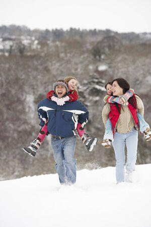 having fun in the snow: Family Having Fun In Snowy Countryside