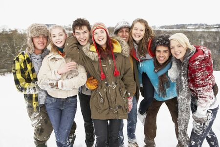 Group Of Teenage Friends Having Fun In Snowy Landscape Stock Photo - 7177858