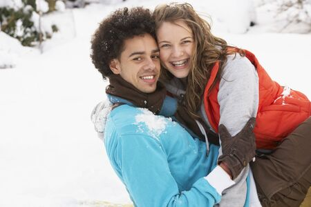 Romantic Teenage Couple Having Fun In Snow Stock Photo - 7178587