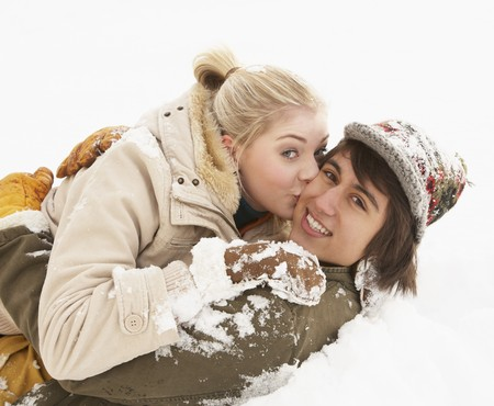 Romantic Teenage Couple Having Fun In Snow photo
