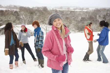 Group Of Young Friends Having Fun In Snowy Landscape photo