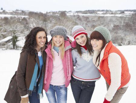Group Of Female Friends Having Fun In Snowy Landscape photo