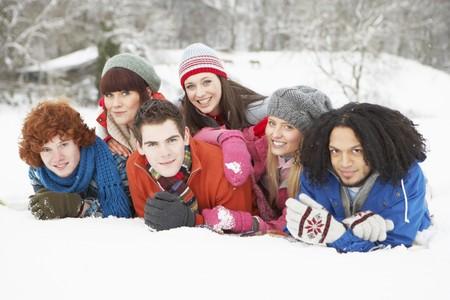 Group Of Teenage Friends Having Fun In Snowy Landscape photo