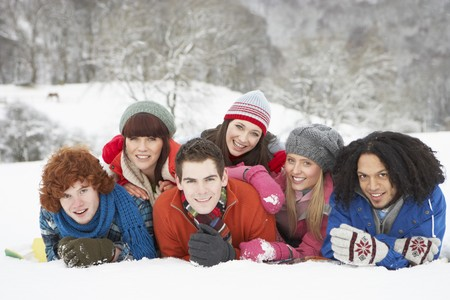 Group Of Teenage Friends Having Fun In Snowy Landscape Stock Photo - 7178594
