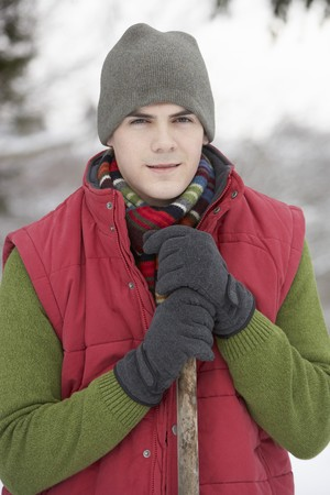 snow clearing: Young Man Clearing Snow From Drive Stock Photo