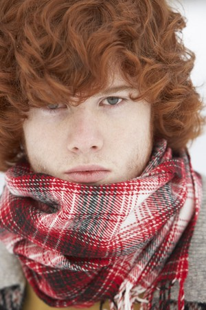 Teenage Boy Wearing Winter Clothes In Snowy Landscape Stock Photo - 7178124