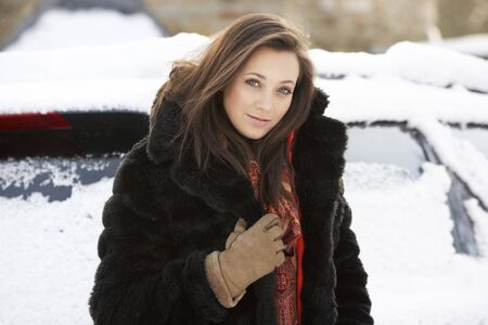 Close Up Of Teenage Girl Wearing Fur Coat In Snowy Landscape photo