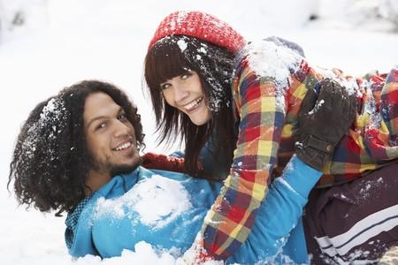 Romantic Teenage Couple Having Fun In Snow photo