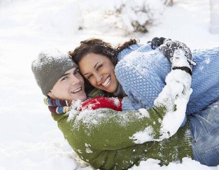 having fun in the snow: Romantic Couple Having Fun In Snow Stock Photo
