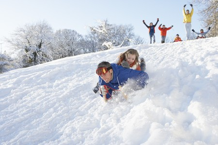 Father And Daughter Having Fun Sledging Down Hill Stock Photo - 7177672