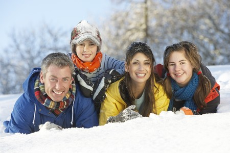 snowy field: Young Family Having Fun In Snowy Landscape Stock Photo