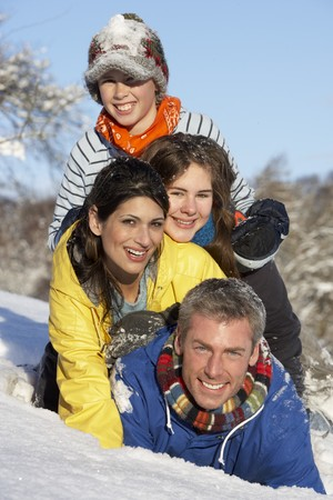 Young Family Having Fun In Snowy Landscape photo