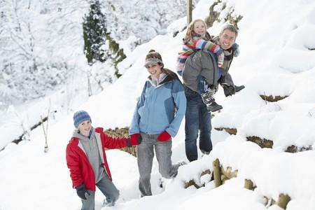 Family Enjoying Walk Through Snowy Landscape Stock Photo - 7177374