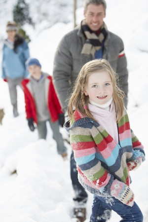 Family Enjoying Walk Through Snowy Landscape Stock Photo - 7177260
