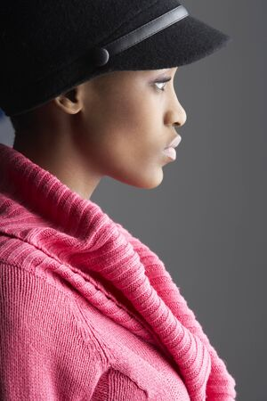 knitwear: Fashionable Young Woman Wearing Cap And Knitwear In Studio