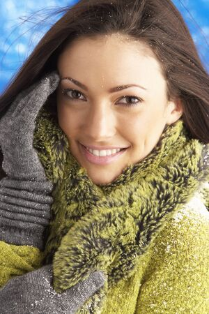 Young Woman Wearing Warm Winter Clothes In Studio photo