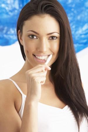 Young Woman Brushing Teeth In Studio Stock Photo - 8453010