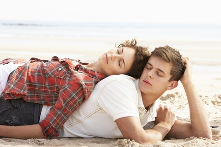 Romantic Young Couple Relaxing On Beach Stock Photo - 8452740
