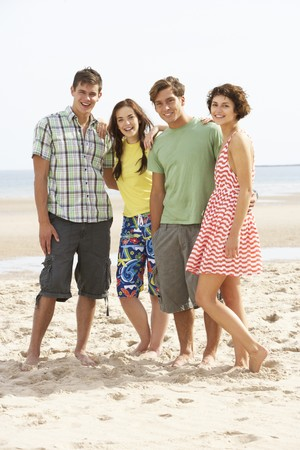 Group Of Teenage Friends Together On Beach photo