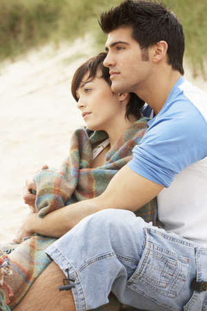 Romantic Young Couple Embracing On Beach photo