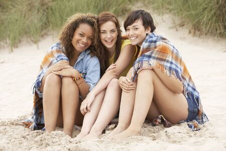 Group Of Girls Sitting On Beach Together Stock Photo - 8452619