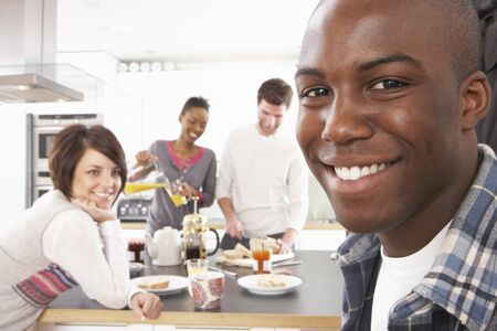 Group Of Young Friends Preparing Breakfast In Modern Kitchen Stock Photo - 8452736