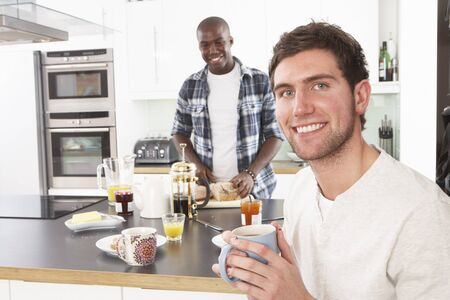 Two Young Men Preparing Breakfast In Modern Kitchen photo