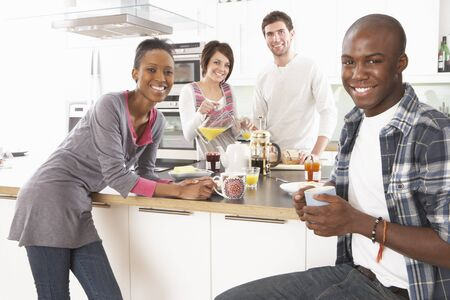 Group Of Young Friends Preparing Breakfast In Modern Kitchen Stock Photo - 8452996