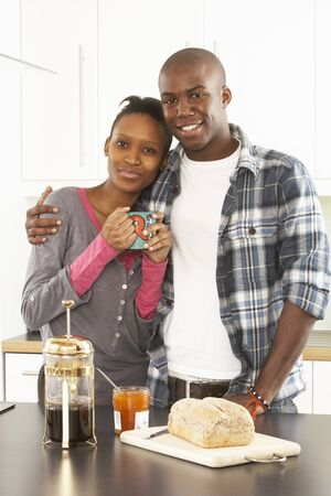 Young Couple Preparing Breakfast In Modern Kitchen photo