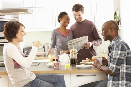 Group Of Young Friends Preparing Breakfast In Modern Kitchen Stock Photo - 8452743