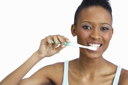 Young Woman Brushing Teeth In Studio Stock Photo - 8453152