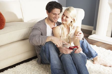 Couple Taking Photograph On Digital Camera At Home Stock Photo - 8453108