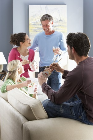 Group Of  Friends Enjoying Chinese Takeaway Meal At Home Stock Photo - 8453219